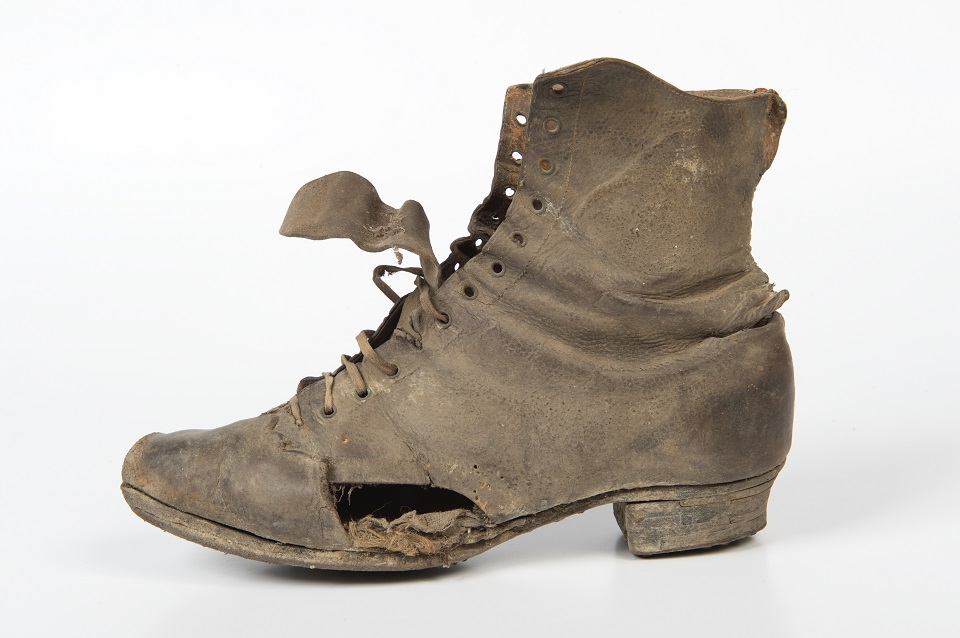 Women's black leather lace ankle boot, 1880s. Found under the bedroom floor of a farm in Shepton Mallet, Somerset