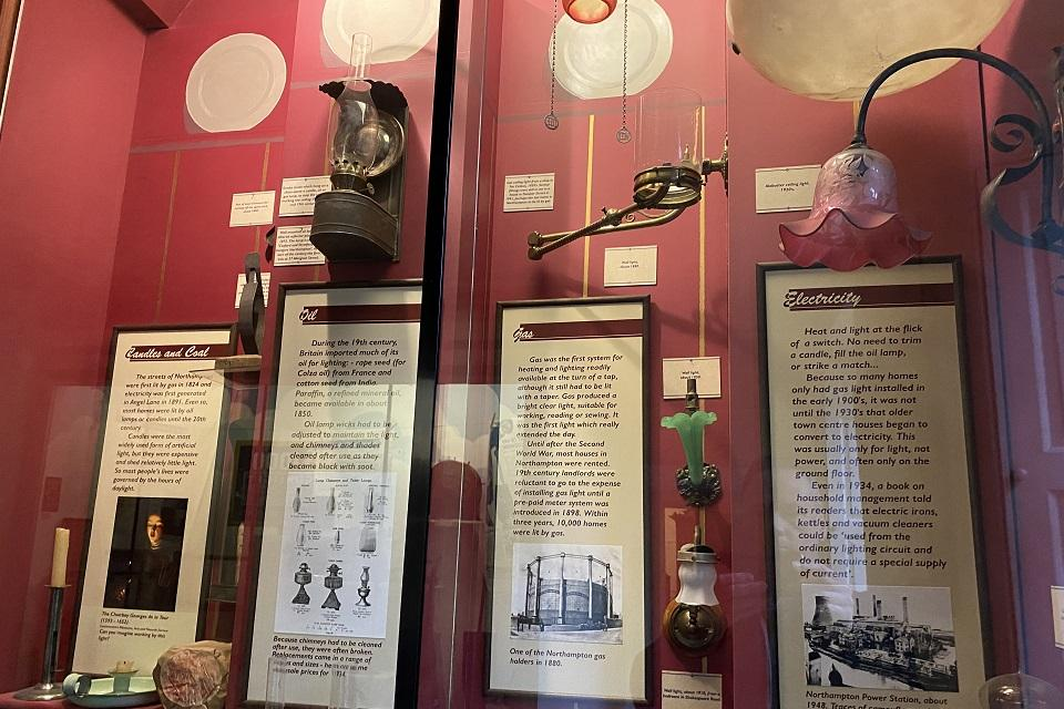 Objects and panel descriptions in case at Abington Park Museum exhibition Cradle to Grave.