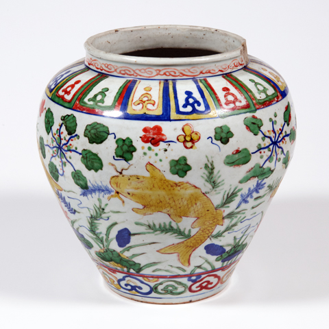 A white jar decorated with yellow carp and multi-coloured natural and geometric shapes