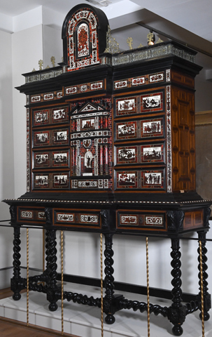 A tall and ornate ebony cabinet known as Spanish Royal Papeleiro cabinet, designed by Diego de Medina